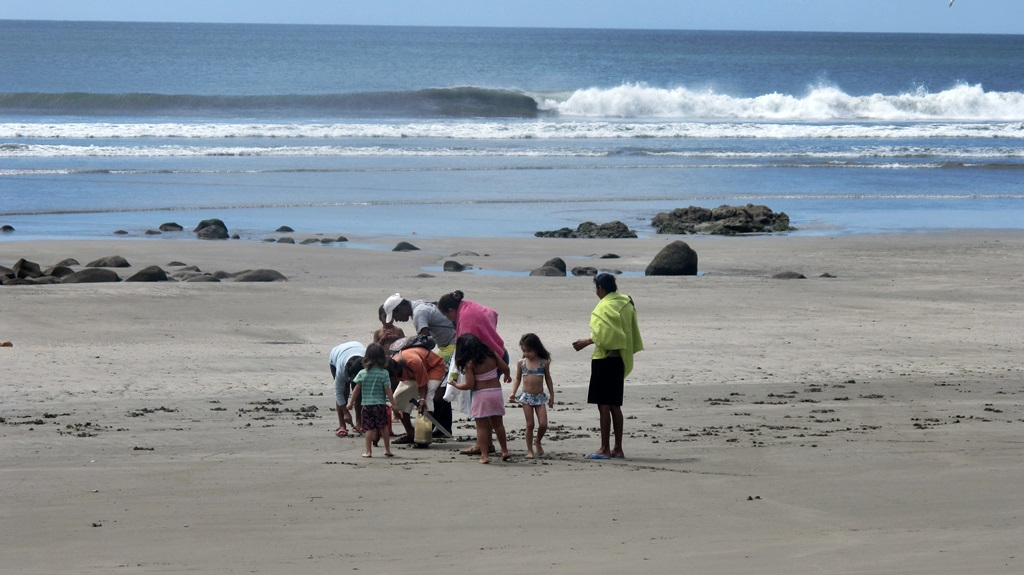locals digging clams on beach in Nicaragua