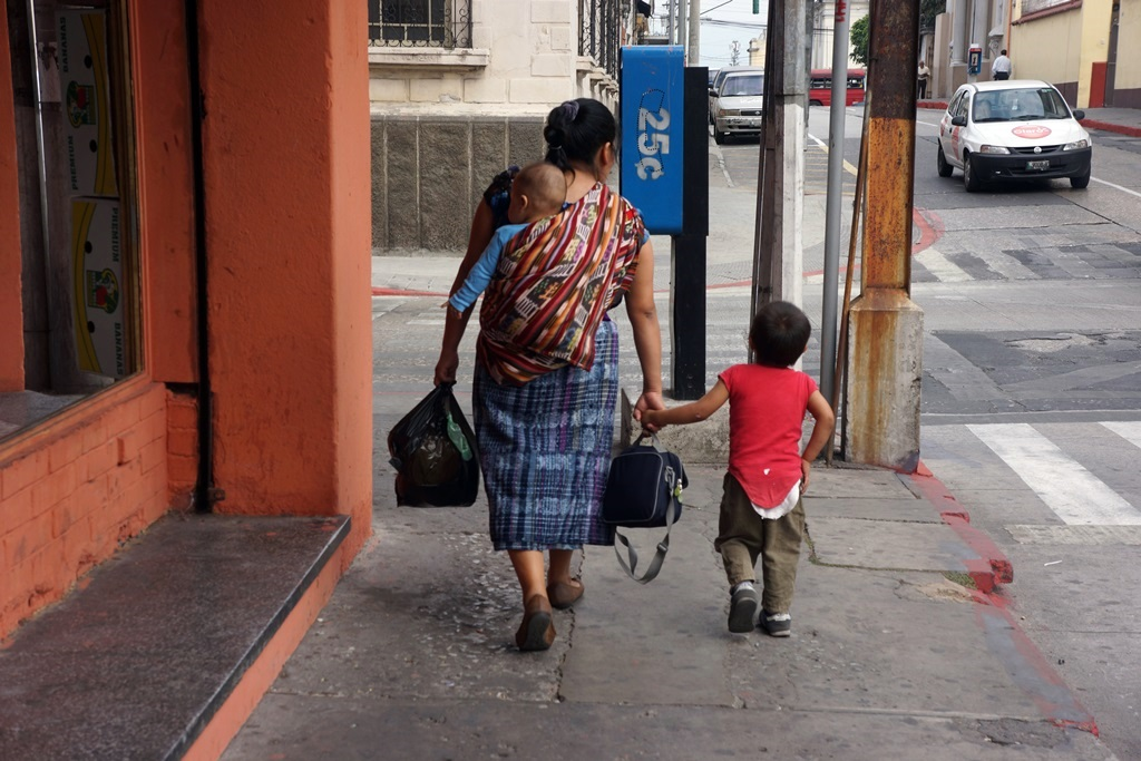 mom and 2 kids in downtown guatemala city